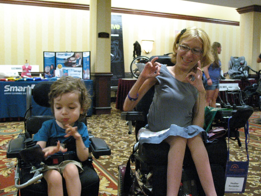 "Oscar and Heather become fast pals at the conference. Seen here making the diver ""OK"" sign together!"