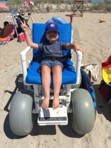 The beach wheelchair! Many public beaches have these available to use free of charge.