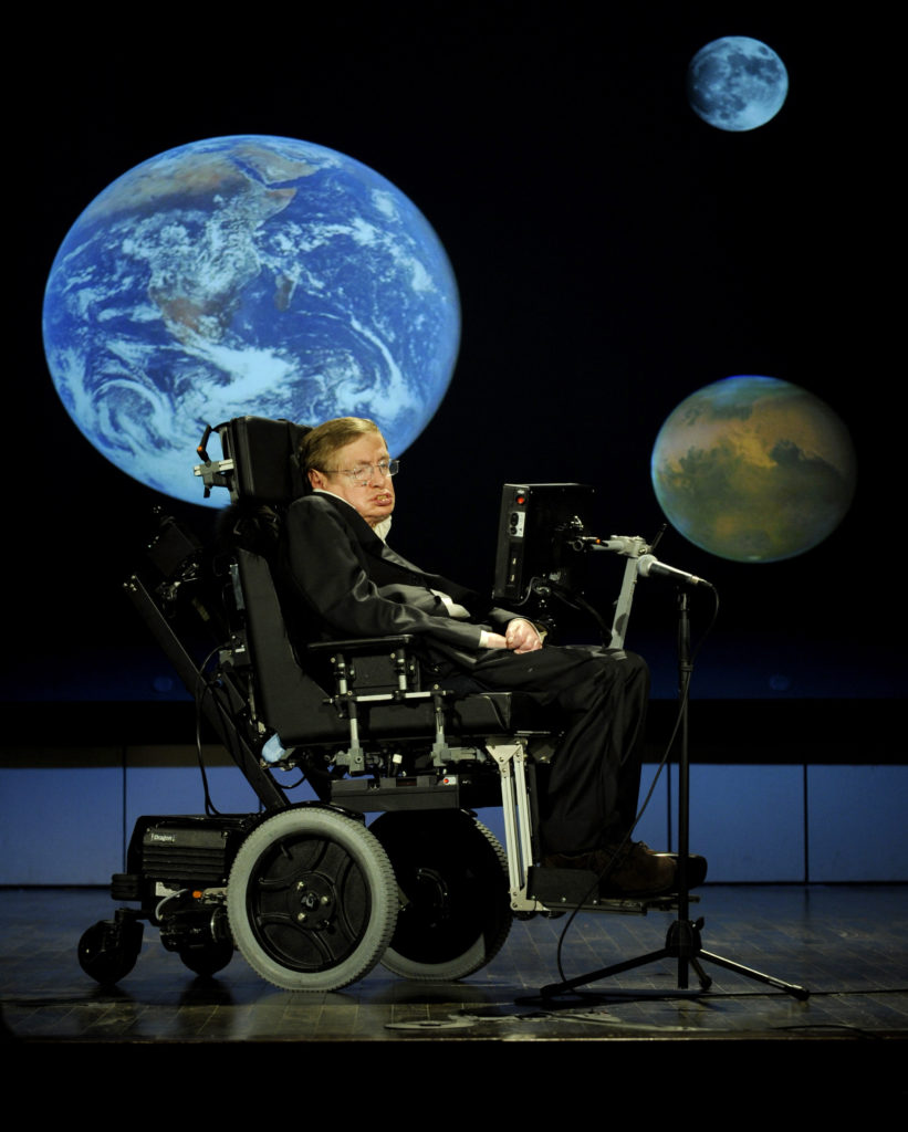 "Dr. Stephen Hawking, a professor of mathematics at the University of Cambridge, delivers a speech entitled ""Why we should go into space"" during a lecture that is part of a series honoring NASA's 50th Anniversary, Monday, April 21, 2008, at George Washington University's Morton Auditorium in Washington. Photo Credit: (NASA/Paul. E. Alers)"