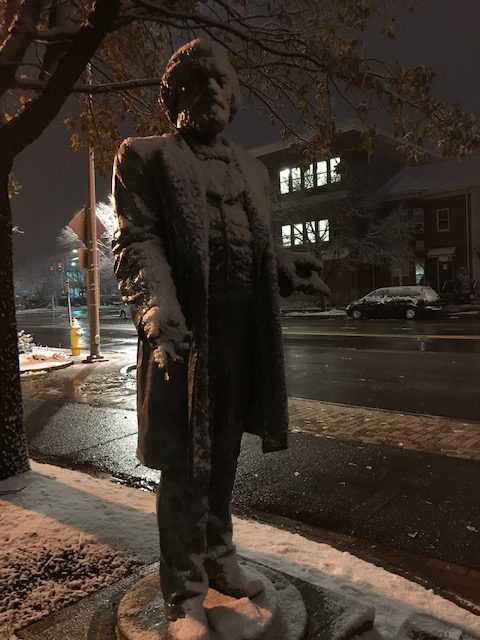 Here is the statue that sits outside Hochstein (the location of Douglass's funeral) in the nighttime snow, after the event.